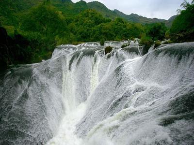 Yinlianzhui Waterfall near Anshun, Guizhou Province, China (© Top Photo Group/Getty Images)